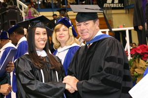 elise-watts-graduates-at