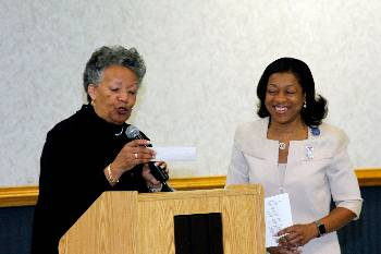 NAA president presents alumni donations