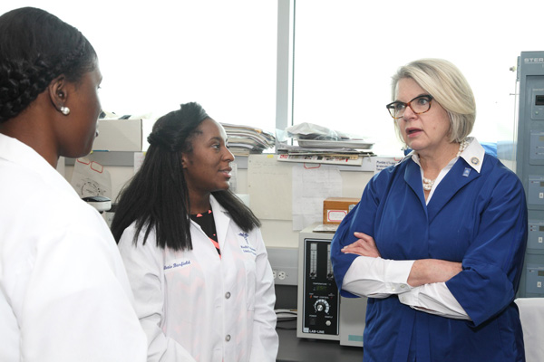 Student researchers talk to UNC President Margaret Spellings.