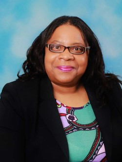 Dr. Juanita Midgette-Spence, Director of Library Services