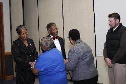Conways greet ECSU employees at reception.