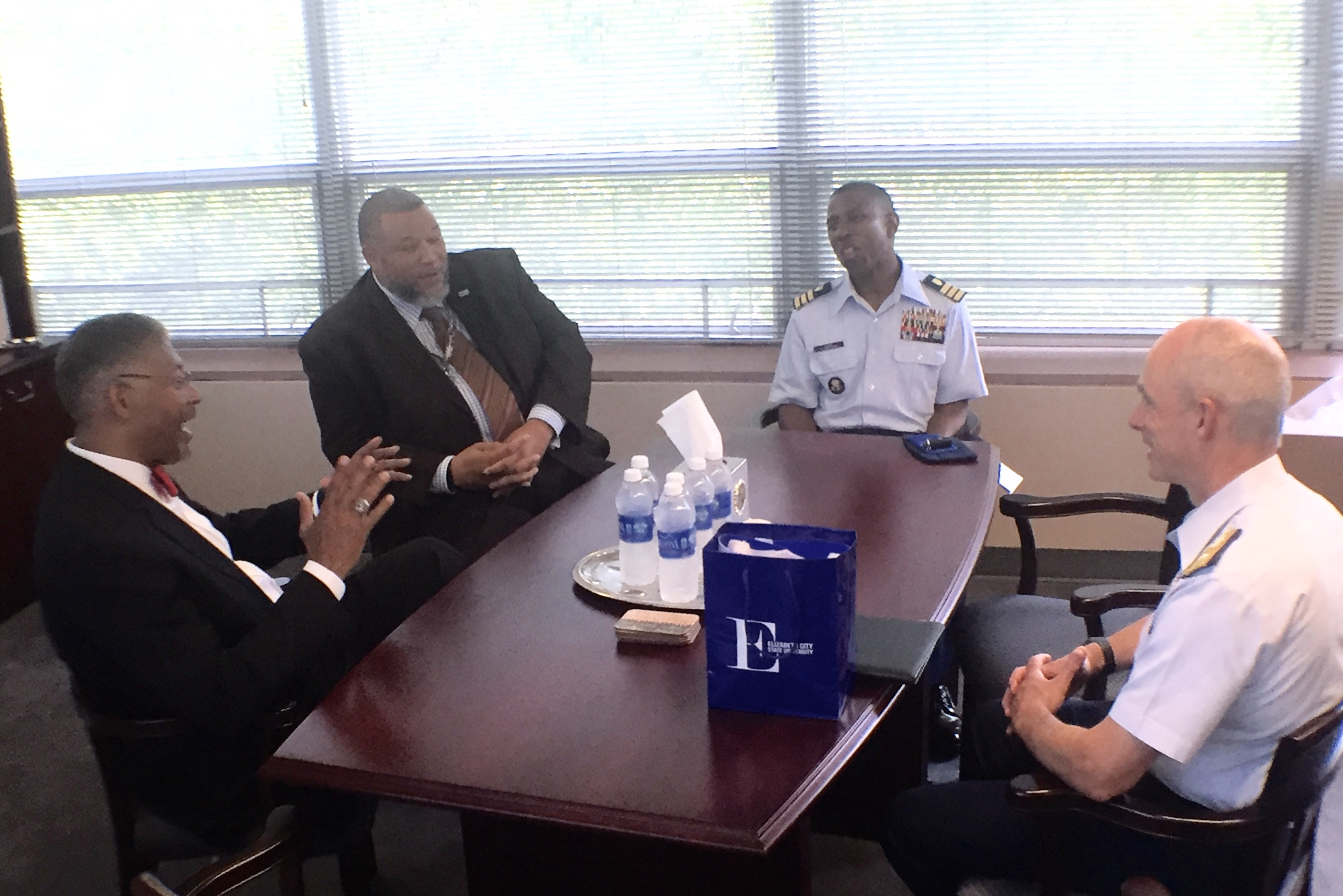 Adm. Bill Kelly visits with chancellor